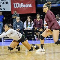 Ramah Mustang Leslie Gabaldon (4), left, digs ahead of teammate Deborah Mc Mahon (2) while playing the Logan Longhorns in the 2A girls state volleyball final at the Santa Ana Star Center in Rio Rancho Saturday.