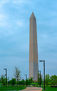 The Washington Monument against a pale blue sky on a clear spring day.