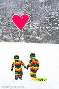 Love is.... photo of two little friends sledding on a snowy afternoon on Sled Hill in Woodstock,NY by Star Nigro. Had fun photoshopping this piece with the additions of the heart and text.<br /> <br /> © 2021 All artwork is the property of STAR NIGRO.  Reproduction is strictly prohibited.<br /> <br /> <br /> © 2019 All artwork is the property of STAR NIGRO.  Reproduction is strictly prohibited.