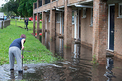 © Licensed to London News Pictures 20/07/2021. Orpington, UK. Residents trying to clear flood water from outside their homes in St Pauls Cray, Orpington. Heatwave thunderstorms hit Orpington in South East London causing roads to flood and drains to overflow. Photo credit:LNP