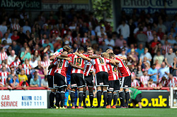 The Brentford squad huddle together prior to the match - Photo mandatory by-line: Patrick Khachfe/JMP - Mobile: 07966 386802 09/08/2014 - SPORT - FOOTBALL - Brentford - Griffin Park - Brentford v Charlton Athletic - Sky Bet Championship - First game of the season