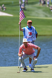 May 2, 2019 - Charlotte, NC, U.S. - CHARLOTTE, NC - MAY 02: Brendon Todd eyes his putt line while his caddy holds the flag on the 14th hole which honors military and veterans during the first round of the Wells Fargo Championship at Quail Hollow on May 2, 2019 in Charlotte, NC. (Photo by William Howard/Icon Sportswire) (Credit Image: © William Howard/Icon SMI via ZUMA Press)