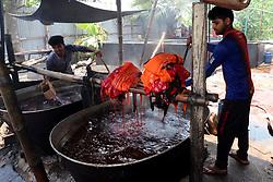 April 26, 2018 - Dhaka, Bangladesh - Bangladeshi labors working in the Batik Cloth industry at Narsingdi area near Dhaka, Bangladesh, on April 26, 2018. Each Worker earns par day 400-500 Taka or 5-6 US Dollar. (Credit Image: © Str/NurPhoto via ZUMA Press)