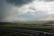 Nederland, Utrecht, Lopikerwaard, 04-03-2008; polderlandschap, Polder Benschop, Polder Willeskop, omgeving Montfoort; regenbuien afgewisseld met zon; veenweide, veen, wei, weiland, gras, sloot, regenwolken, sluier, regensluier, wolken, noodweer, polderen, stroken, verkaveling, kavel,. .luchtfoto (toeslag); aerial photo (additional fee required); .foto Siebe Swart / photo Siebe Swart