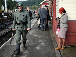© Licensed to London News Pictures. <br /> 15/10/2016. <br /> Levisham, UK.  <br /> <br /> A re-enactor dressed as a German soldier walks along the platform at Levisham station during the North Yorkshire Moors Railway Wartime Weekend event. <br /> The annual event brings together re-enactors and enthusiasts along the length of the NYMR heritage steam railway line to recreate the feel of the war years of the 1940's. <br /> <br /> Photo credit: Ian Forsyth/LNP