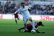 Swansea city's Michu goes past Newcastle's Mapou Yanga-Mbiwa.  Barclays premier league, Swansea city v Newcastle Utd at  the Liberty stadium in Swansea, South Wales on Saturday 2nd March 2013. pic by  Andrew Orchard, Andrew Orchard sports photography,