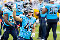 NASHVILLE, TN - OCTOBER 25:  Nick Dzubnar #49 of the Tennessee Titans signals #1 as he runs off the field in the second half of a game against the Pittsburgh Steelers at Nissan Stadium on October 25, 2020 in Nashville, Tennessee.  The Steelers defeated the Titans 27-24.  (Photo by Wesley Hitt/Getty Images) *** Local Caption *** Nick Dzubnar