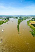 Nederland, Gelderland, Gemeente Lingewaard, 09-06-2016; de Pannerdensche Kop gezien in Noordwestelijke richting, de Rijn splitst zich hier in Waal (links, richting Nijmegen) en Pannerdensch Kanaal (rechts, overgaand in Neder-Rijn richting Arnhem). Het voormalig Fort Pannerden ligt ongeveer halverwege de landtong. Door de overvloedige regenval in Duitsland is er sprake van hoogwater. <br /> The Rhine bifurcates into river Waal (left, direction Nijmegen) and Pannerdensch Channel (right, becoming Lower Rhine direction of Arnhem). The former Fort Pannerden is located about halfway between the headland. Because of the abundant rainfall in Germany, there is high water.<br /> <br /> luchtfoto (toeslag op standard tarieven);<br /> aerial photo (additional fee required);<br /> copyright foto/photo Siebe Swart