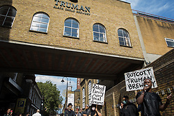 London, UK. 12th September, 2021. Abdi Hassan of Coffee Afrik CIC addresses local residents and supporters of the Save Brick Lane campaign outside the Truman Brewery following a funeral procession along Brick Lane organised in protest against the ongoing gentrification of Shoreditch. Campaigners are protesting in particular against plans to develop the Truman Brewery into a shopping centre and 5-storey office building. Tower Hamlets experienced more gentrification than any other London borough between 2010-2016.