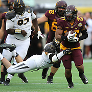 ORLANDO, FL - JANUARY 01:  David Cobb #27 of the Minnesota Golden Gophers is tackled by Shane Ray #56 of the Missouri Tigers during the Buffalo Wild Wings Citrus Bowl at the Florida Citrus Bowl on January 1, 2015 in Orlando, Florida. (Photo by Alex Menendez/Getty Images) *** Local Caption ***  David Cobb; Shane Ray