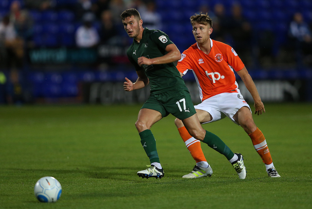 Tranmere Rovers' Jake Kirby shields the ball from Blackpool's Will Aimson<br /> <br /> Photographer Stephen White/CameraSport<br /> <br /> Football - Pre-Season Friendly - Tranmere Rovers v Blackpool - Tuesday 26 July 2016 - Prenton Park - Birkenhead<br /> <br /> World Copyright © 2016 CameraSport. All rights reserved. 43 Linden Ave. Countesthorpe. Leicester. England. LE8 5PG - Tel: +44 (0) 116 277 4147 - admin@camerasport.com - www.camerasport.com