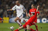 24/3/2004 Madrid, Spain.<br />Champions League. 1/4 Finals, 1 Leg.<br />R.Madrid 4 - AS Monaco 2<br />R.Madrid's  Zidane in duel against Monaco's Evra at Santiago Bernabeu's Stadium.<br />© 2004 Alejandro leon Fernandez