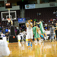 031314  Adron Gardner/Independent<br /> <br /> The Texico Wolverines celebrate after beating the Laguna Acoma Hawks 63-59 in the 2A boys semifinal game during the state high school basketball tournament at the Santa Ana Star Center in Rio Rancho Thursday.