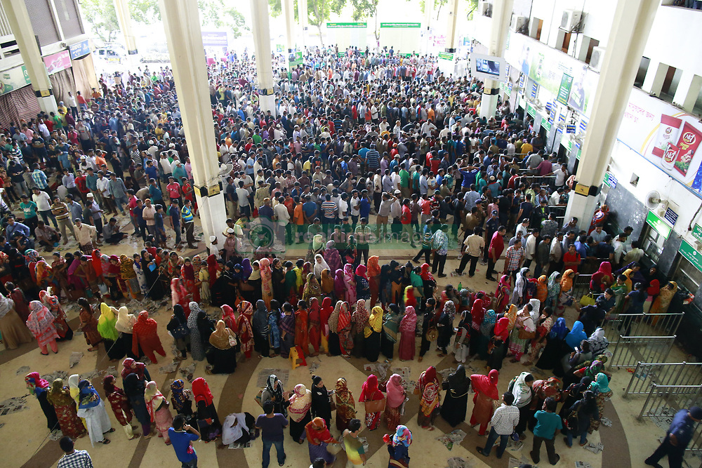 June 16, 2017 - Dhaka, Bangladesh - Bangladeshi people stands on queue to collect tickets at Komolapur railway station as the Bangladesh Railways start selling advance tickets ahead of the Eid al-Fitr holiday in Dhaka, Bangladesh, June 16, 2017. Eid al-Fitr is an important religious holiday celebrated by Muslims worldwide that marks the end of Ramadan, the Islamic holy month of fasting. (Credit Image: © Suvra Kanti Das via ZUMA Wire)