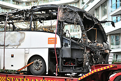 © Licensed to London News Pictures. 22/12/2019. London, UK. The coach being taken away on the back of a lorry. The scene in Battersea, London where one person has does in a crash between a coach and a Zip Car . Photo credit: Ben Cawthra/LNP