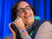 """01 FEBRUARY 2020 - DES MOINES, IOWA: ELLEN LUGER, from Minneapolis, a close friend of US Senator Amy Klobuchar (D-MN) puts on her """"Amy Earrings"""" before a campaign event for Sen. Klobuchar. Sen. Klobuchar campaigned to support her candidacy for the US Presidency Saturday in Iowa. She is trying to capitalize on her recent uptick in national polls. Iowa holds the first selection event of the presidential election cycle. The Iowa Caucuses are Feb. 3, 2020.             PHOTO BY JACK KURTZ"""