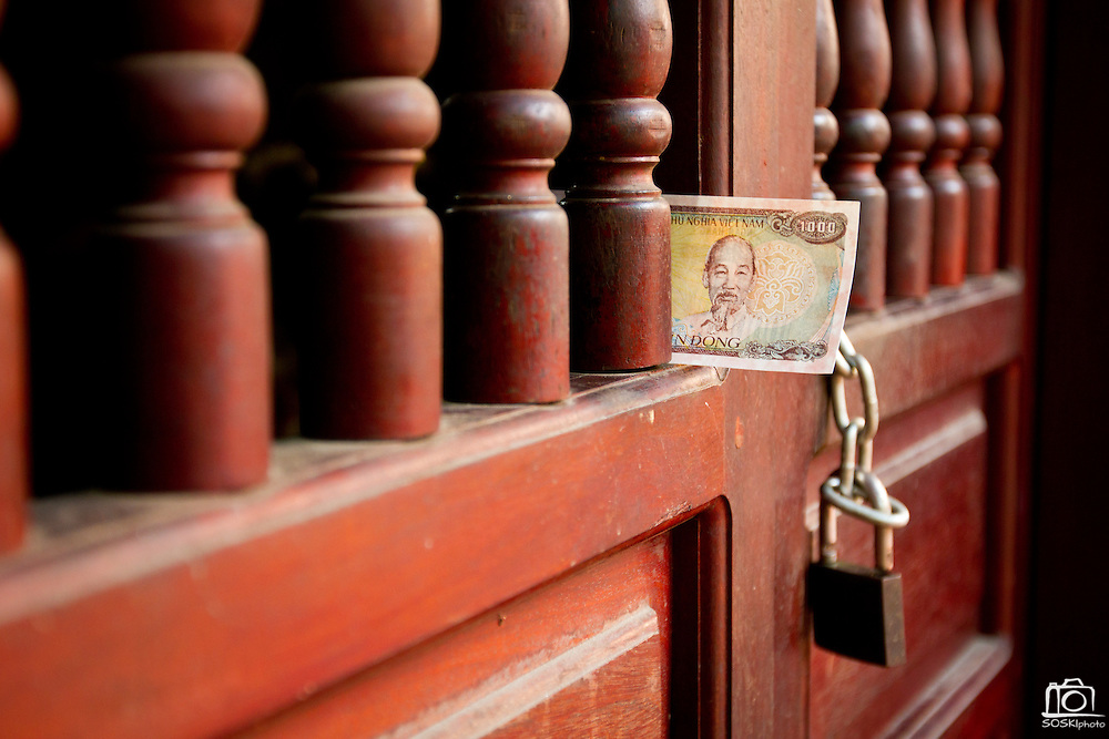 1000 Dong (equivalent to five cents USD) sits on the window of a pagoda in Hanoi, Vietnam.  The face of former Republic of Vietnam president, Ho Chi Minh, is impressed throughout Northern Vietnam.  Photo by Stan Olszewski/SOSKIphoto