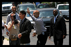 May 19th, 2006. New Orleans, Louisiana. Mayor Ray Nagin takes a moment to have fun with TV reporter Thanh Truong of WWLTV, a CBS affiliate. Truong was covering the last scheduled  official campaign engagement at Wholefoods Supermarket in Uptown New Orleans before the ren off elections tomorrow, Saturday May 20th.<br /> Photo; Charlie Varley/varleypix.com