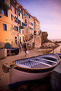 A rowboat is pulled out of the water in La Spezia, Italy