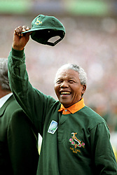S.A. President Nelson Mandela waves to the crowd just before kick off in RWC Final, New Zealand v South Africa at Golden Lions' Ellis Park in Johannesburg, South Africa
