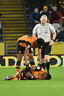 Hull City midfielder Moses Odubajo after sliding tackel by Bolton Wanderers midfielder Mark Davies  during the Sky Bet Championship match between Hull City and Bolton Wanderers at the KC Stadium, Kingston upon Hull, England on 12 December 2015. Photo by Ian Lyall.