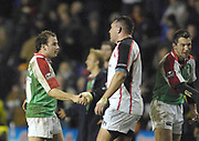 Reading, GREAT BRITAIN, Exiles, [L]  Paul HODGSON, [R] Justin BISHOP,  shake hands with the Ulster players after the final whistle,  third round Heineken Cup game, London Irish vs Ulster Rugby, at the Madejski Stadium, Reading ENGLAND, Sat., <br /> 09.12.2006. [Photo Peter Spurrier/Intersport Images]