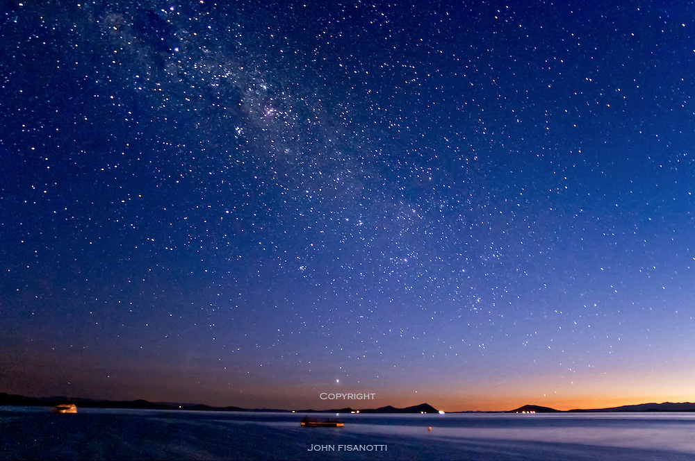 The Milky Way comes out at evening twilight over Lake Titicaca as seen from Huatajata, Bolivia