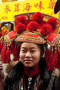 A young woman in a traditional headdress prior to the start of the parade.