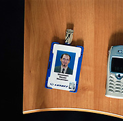 The identity card of Michael M Minkevic, director of  business development at Luxoft next to his phone .From the series Desk Job, a project which explores globalisation through office life around the World.