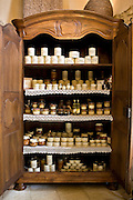 Foie gras and other farm products in kilner preserving jars in armoire on sale at farm, La Ferme de Charnaillas, Dordogne, France
