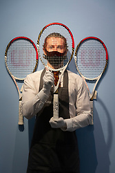 © Licensed to London News Pictures. 21/06/2021. London, UK. Roger Federer's three tennis racquets used in The Lon don Olympics with an estimate ofd £7,000-10,000 are part of the Roger Federer Collection at Christies Auction House. Proceed from the evening and online sale will benefit the RF Foundation. Photo credit: Ray Tang/LNP