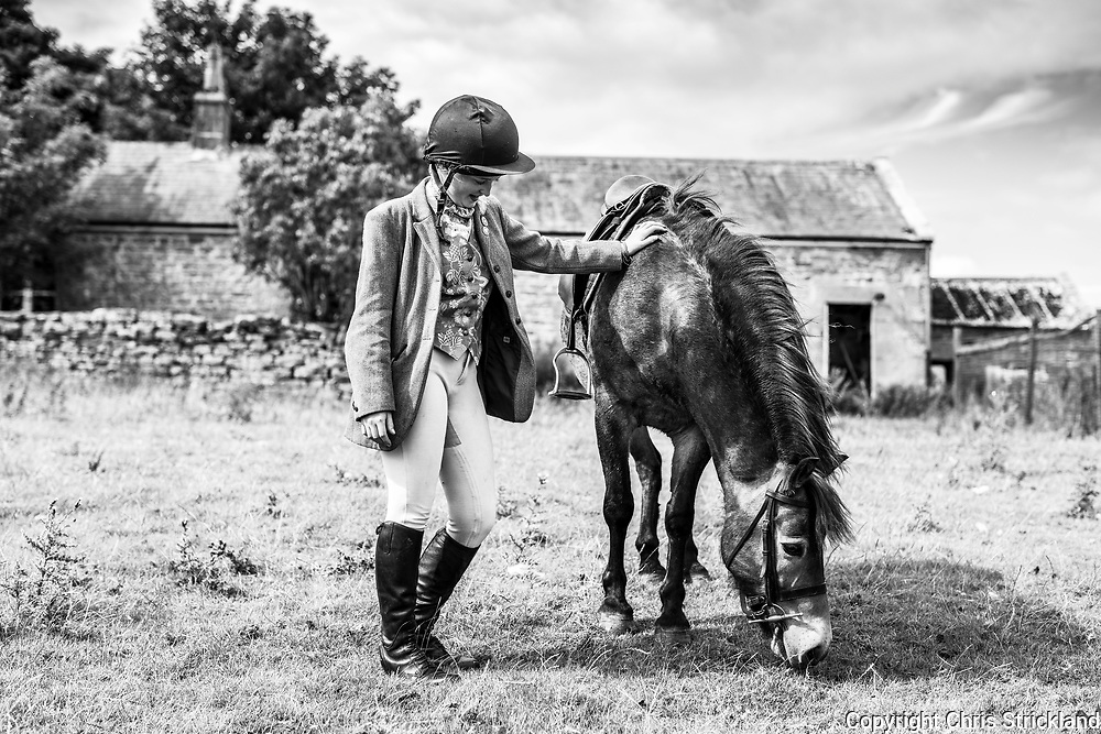 Haltwhistle, Northumberland, England, UK. 4th August 2018. A group of falconers on horseback, led by Dr. Nick Fox OBE, hunt crows on the Northumberland moors along Hadrians Wall, using Peregrine Saker falcons.