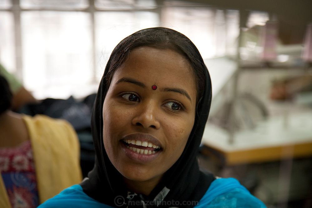 Ruma Akhter, 20, works as a seamstress for the Ananta Garment Company in Dhaka, Bangladesh. (Featured in the book What I Eat: Around the World in 80 Diets.) MODEL RELEASED.