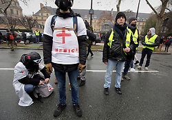 19 January 2019. Paris, France.<br /> Gilets Jaunes - Acte X take to the streets of Paris. Medics prepare for trouble at the end of the demonstration. An estimated 7,000 people took part in the looping 14 km route from Place des Invalides to protest tax hikes from the Government of Emmanuel Macron imposed on the people. An estimated 80,000 people took part in protests across the country. Regrettably the movement has attracted a violent element of agitators who often face off with riot police at the end of the marches which tends to deflect attention away from the message of the vast majority of peaceful protesters.<br /> Photo©; Charlie Varley/varleypix.com