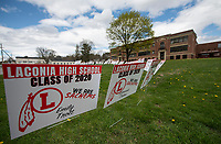 Signs displayed for each graduating senior on the front lawn of Laconia High School.  (Karen Bobotas/for the Laconia Daily Sun)