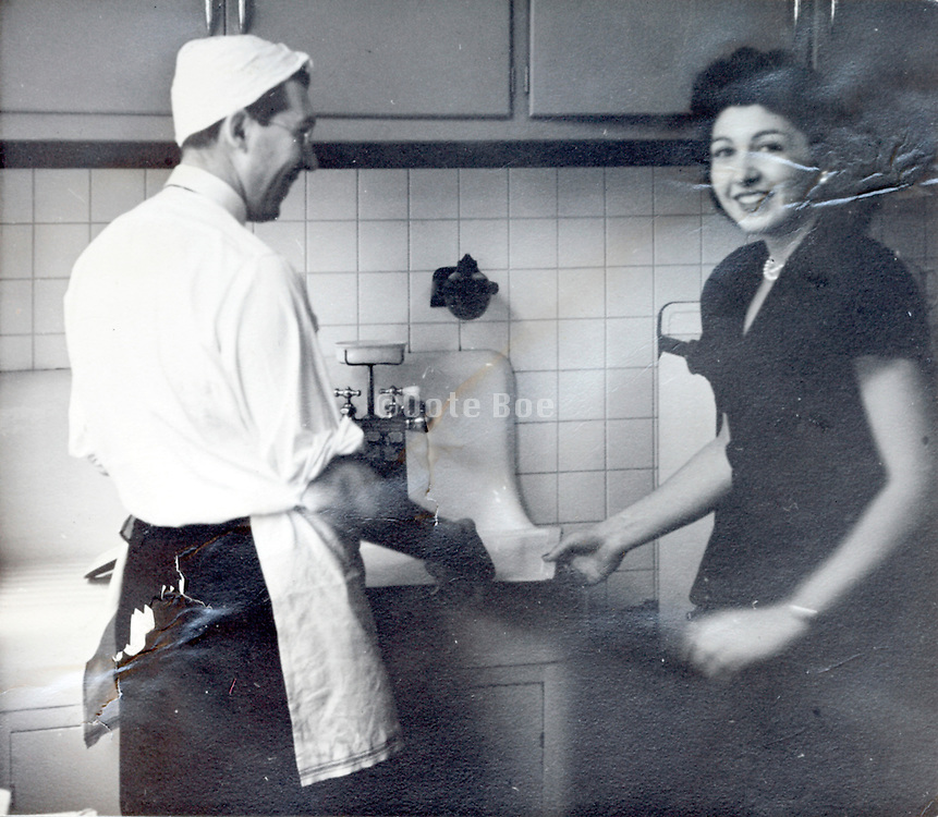 male person doing the dishes USA 1940s