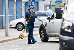 © Licensed to London News Pictures. 27/05/2019. London, UK.  Police search team at the crime scene in St Paul's Way, Mile End in Tower Hamlets, where a 23 year old man was stabbed multiple times yesterday, 26th May and died overnight in hospital.  Photo credit: Vickie Flores/LNP