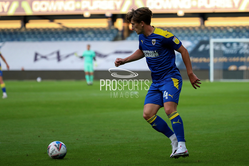 AFC Wimbledon midfielder Alex Woodyard (4) dribbling during the EFL Trophy Group O match between AFC Wimbledon and Charlton Athletic at the Kiyan Prince Foundation Stadium, London, England on 1 September 2020.