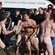 Action during the 'Nude Blacks' versus a Fijian invitation side played at Logan Park, Dunedin as an unofficial curtain raiser match before the New Zealand V Fiji test match in Dunedin, New Zealand.....The 'Nude Blacks' played a Fijian invitation side at Logan Park, Dunedin, an 'unofficial'  curtain raiser before the New Zealand All Blacks test match against Fiji in Dunedin, New Zealand. .The 'Nude Blacks' won the match 20-10 with 21 year old female player Rachel Scott, a member of the Otago women's rugby team named player of the day. .Over 500 people turned up to watch the match which included a blind referee, Julie Woods and three clothed streakers who were ejected from the playing area..The 'Nude Blacks' traditionally play games before test matches in Dunedin and were using this match as a warm up for three nude games planned during the IRB Rugby World Cup in New Zealand with teams from Argentina, Italy, England and Ireland involved.  Matches will be played before World Cup games in Dunedin. New Zealand. 22nd July 2011. Photo Tim Clayton