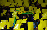 Football - 2018 / 2019 Premier League - Arsenal vs. Cardiff City<br /> <br /> A Cardiff City fan holds aloft a Nantes flag, the club that Emiliano Sala was leaving Cardiff city for, at The Emirates.<br /> <br /> COLORSPORT/ASHLEY WESTERN