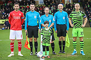 Mascot and captains during the EFL Sky Bet League 2 match between Forest Green Rovers and Swindon Town at the New Lawn, Forest Green, United Kingdom on 21 December 2019.