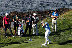June 11, 2019 - Pebble Beach, CA, U.S. - PEBBLE BEACH, CA - JUNE 11: PGA golfer Dustin Johnson tees off on the 8th hole during a practice round for the 2019 US Open on June 11, 2019, at Pebble Beach Golf Links in Pebble Beach, CA. (Photo by Brian Spurlock/Icon Sportswire) (Credit Image: © Brian Spurlock/Icon SMI via ZUMA Press)