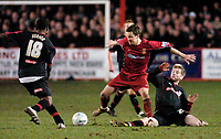 Photo: Leigh Quinnell.<br /> Tamworth v Stoke City. The FA Cup. 17/01/2006. Tamworths Graham Ward skips past Stokes Junior and Paul Gallagher.