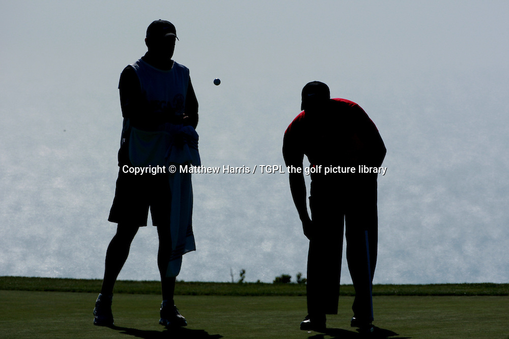 Tiger WOODS (US) throws ball to caddie Steve WILLIAMS (NZL)  at the 14th green during fourth round  US Open Championship, Torrey Pines,San Diego, California,USA,15th June 2008.