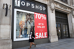 © Licensed to London News Pictures. 14/06/2020. London, UK. The Regent Street branch of Topshop advertises a sale. The government has announced that all non-essential retailers can re-open on Monday 15 June as the coronavirus lockdown restrictions are eased . Photo credit: George Cracknell Wright/LNP
