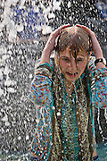 Moscow, Russia, 14/07/2006..Teenagers cool off in fountains on Manezh Square by the Kremlin during a heatwave.