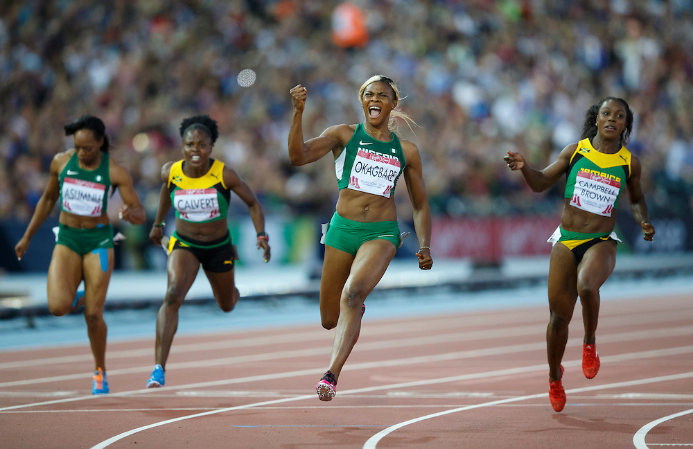 Athletics. Women's 100m Final. Blessing Okagbare of Nigeria wins and celebrates.
