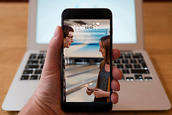 Using iPhone smartphone to display homepage of Match.com the online dating website