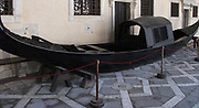 Gondola preserved in the Doge's Palace Courtyard, Venice. Built in Venetian Gothic style the palace was the residence of the Doge of Venice (the supreme authority of the rublic of Venice). It is now open as a museum.