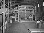 5592Arm picker section of the stationary hop picker at the E. Clemens Horst hop ranch near Independence, Oregon. September 1, 1942.